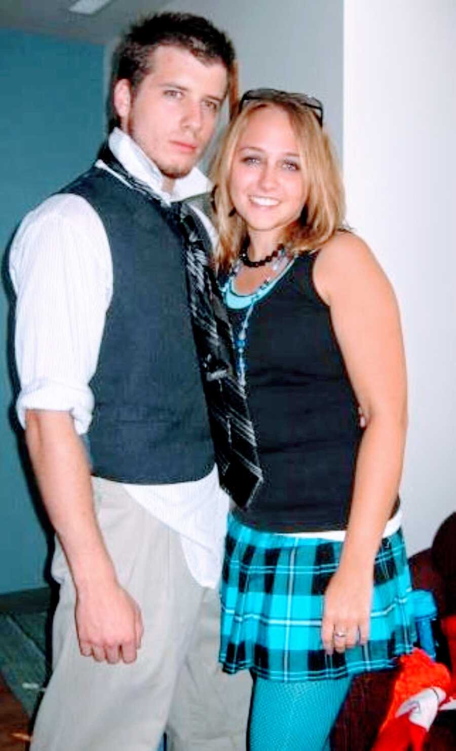 Young college sweethearts take a silly photo together, wearing matching ties