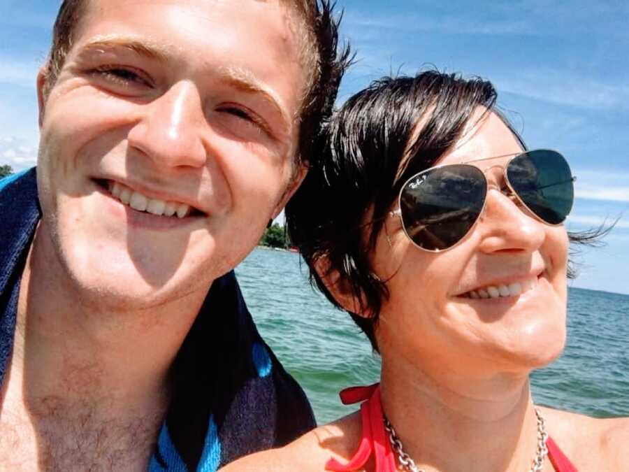 Mom takes a selfie with her oldest son while on a boat together for a family vacation