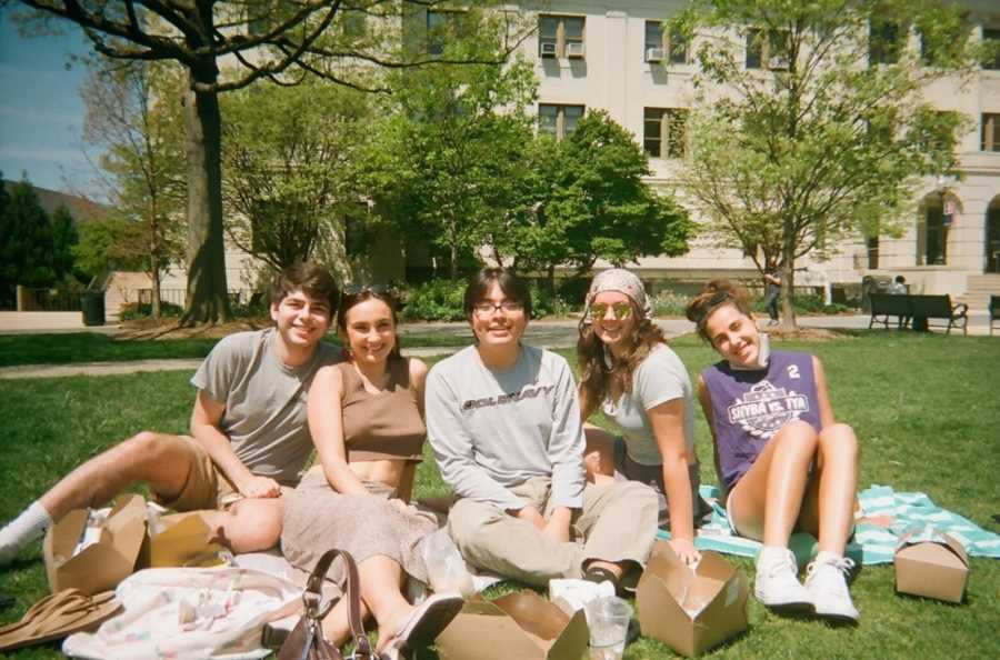 five students on lawn