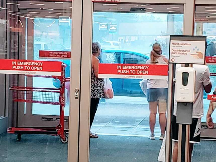 Mom takes a photo of shoppers waiting in Target for the heavy rain to stop before she went out in it