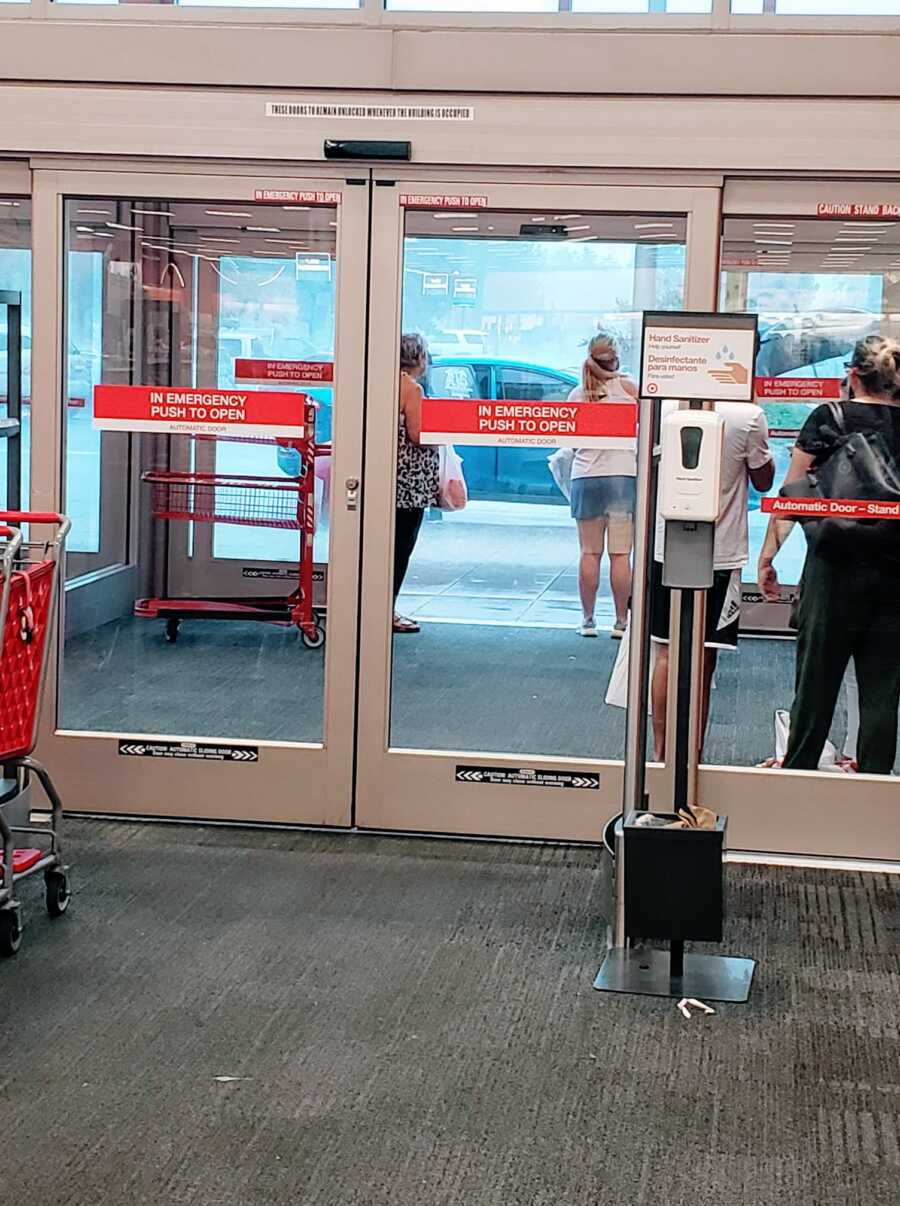 Mom snaps photo of shoppers waiting for the rain to let up before leaving Target