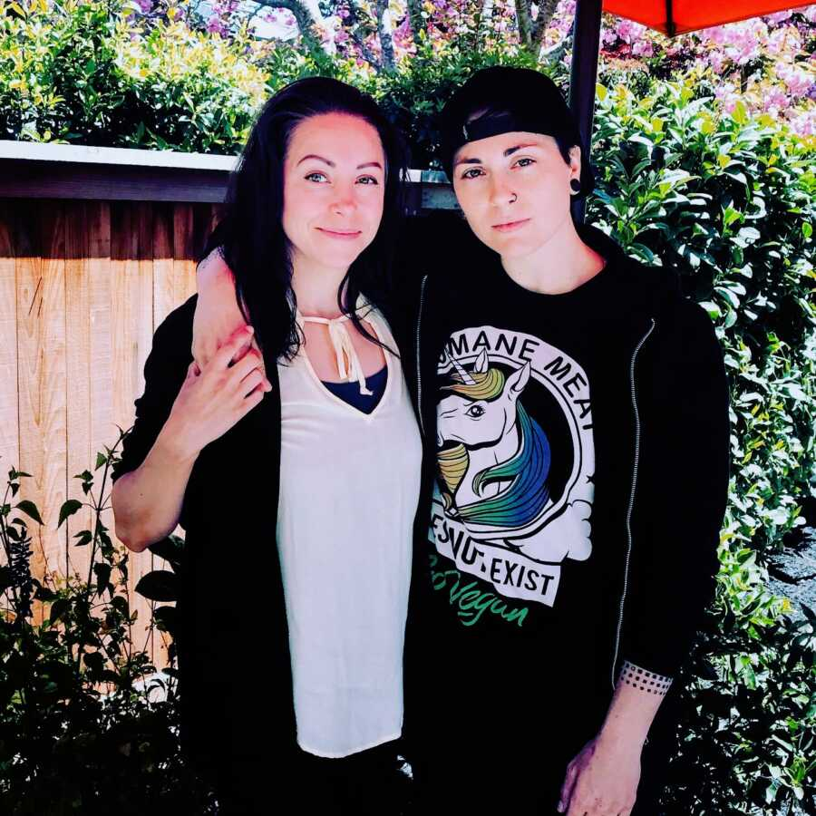 Woman recently diagnosed with autism and ADHD as an adult poses for a photo with their nonbinary partner
