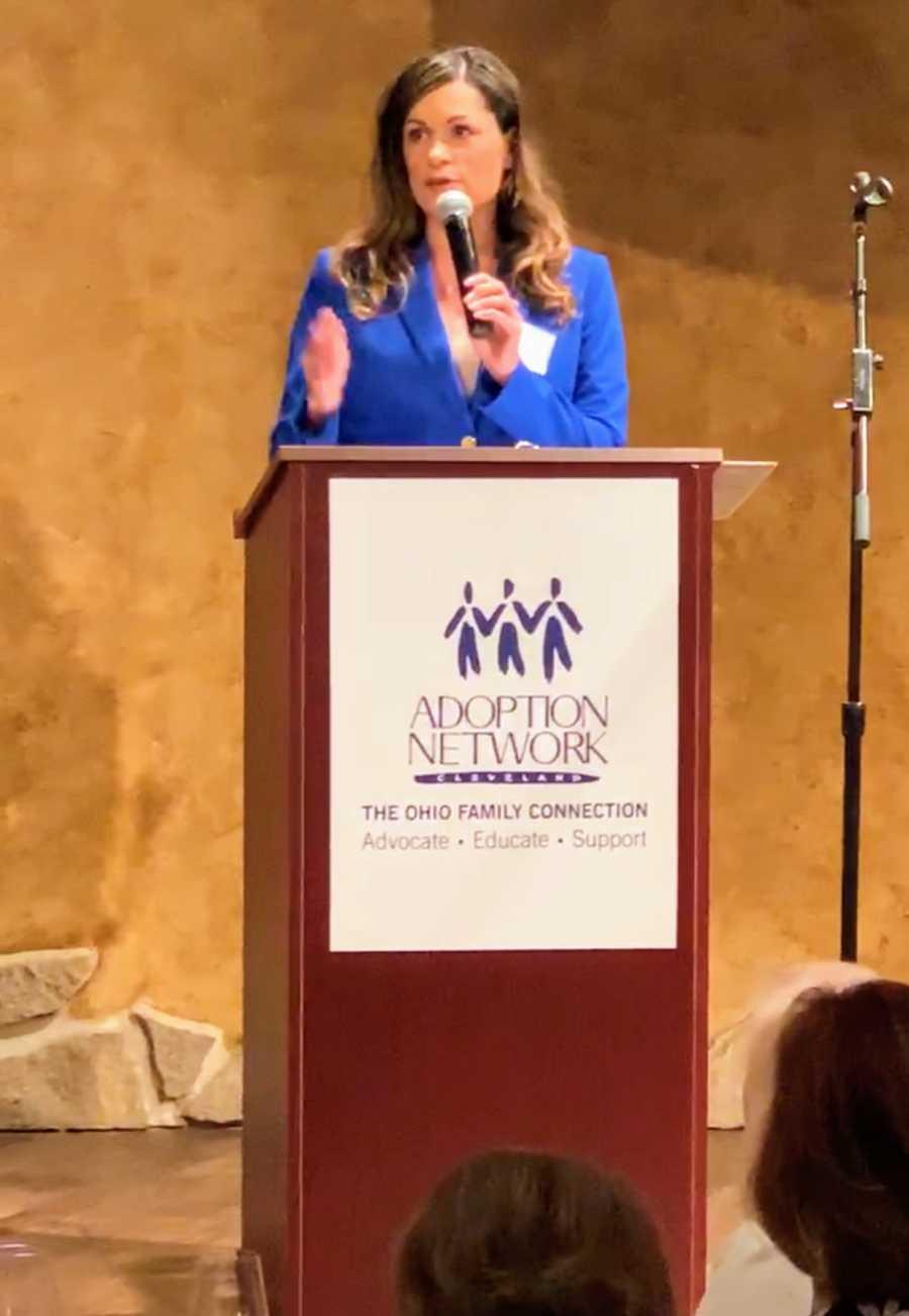woman speaking at organization