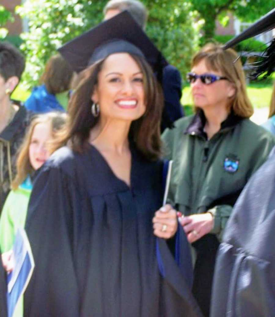 woman graduating college wearing cap and gown