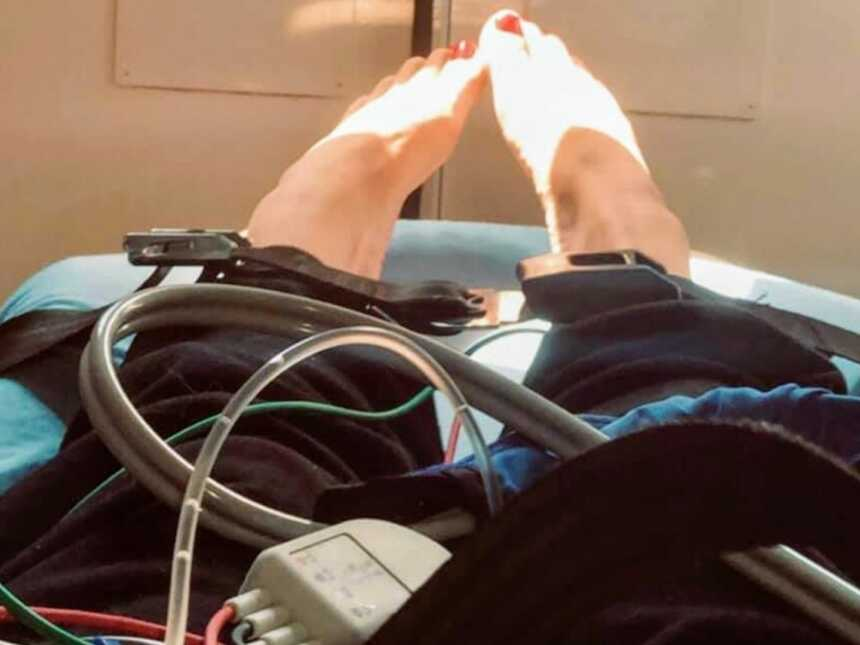 Woman suffering from anxiety takes a photo in the back of an ambulance after a bad panic attack