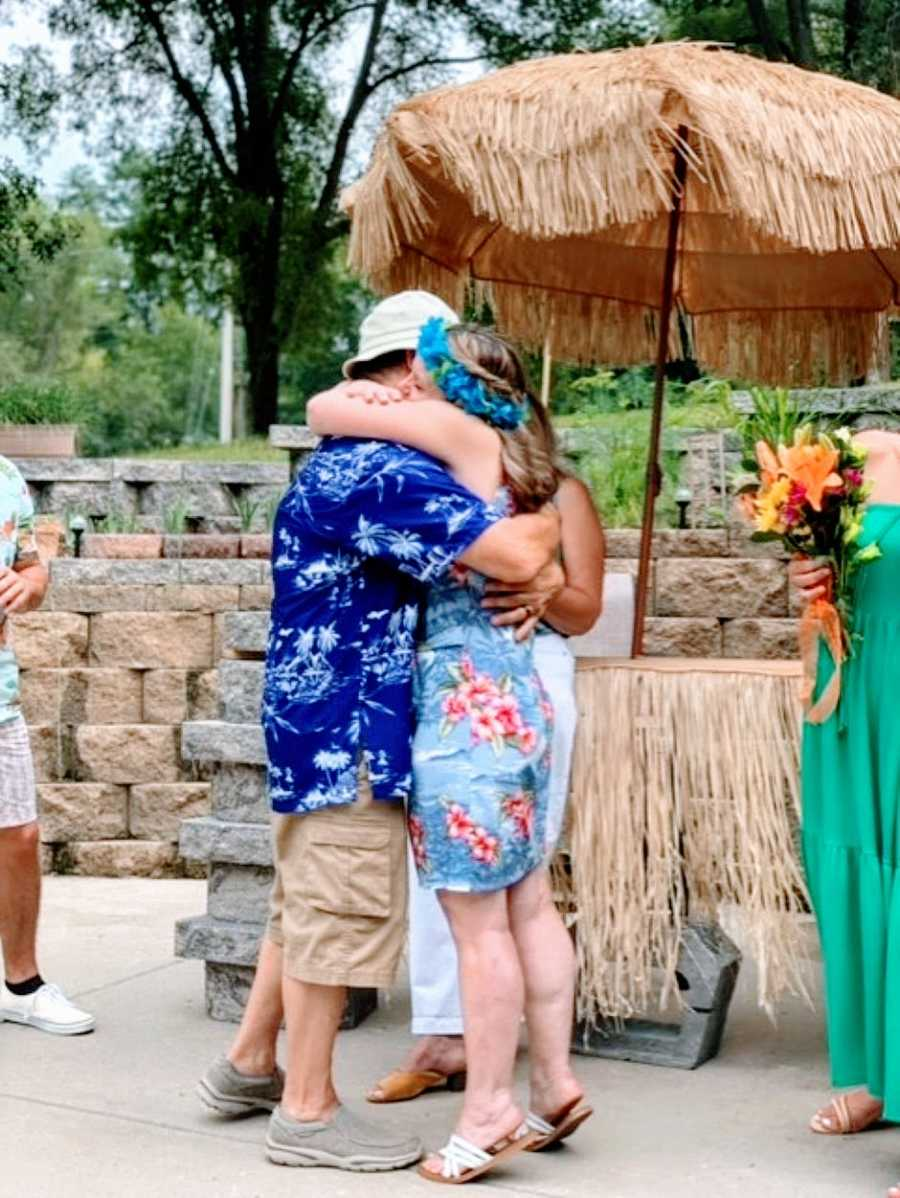 Couple getting remarried after husband recovered from alcoholism share and intimate and loving hug during the ceremony