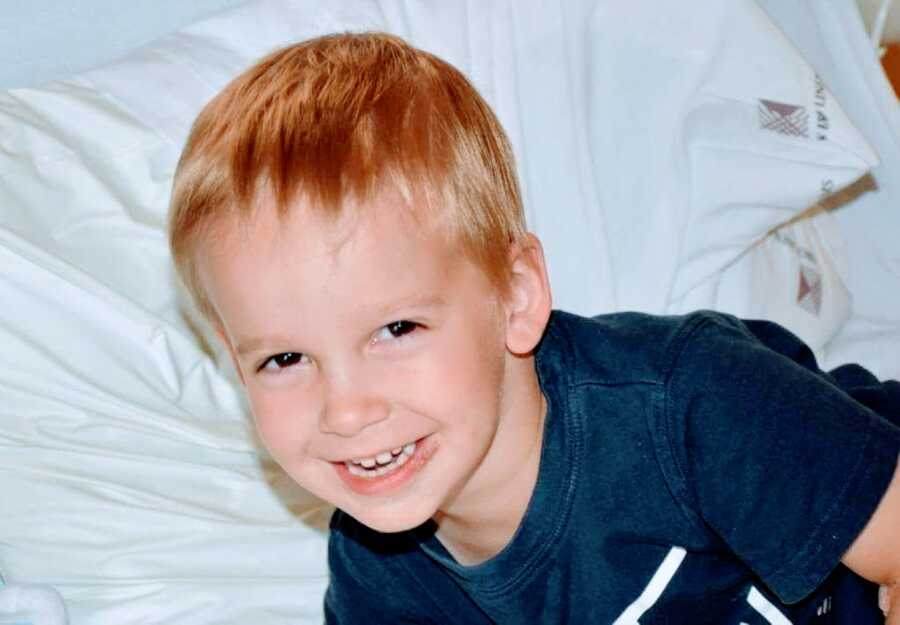 Little boy with undiagnosed seizures smiles while in a hospital bed