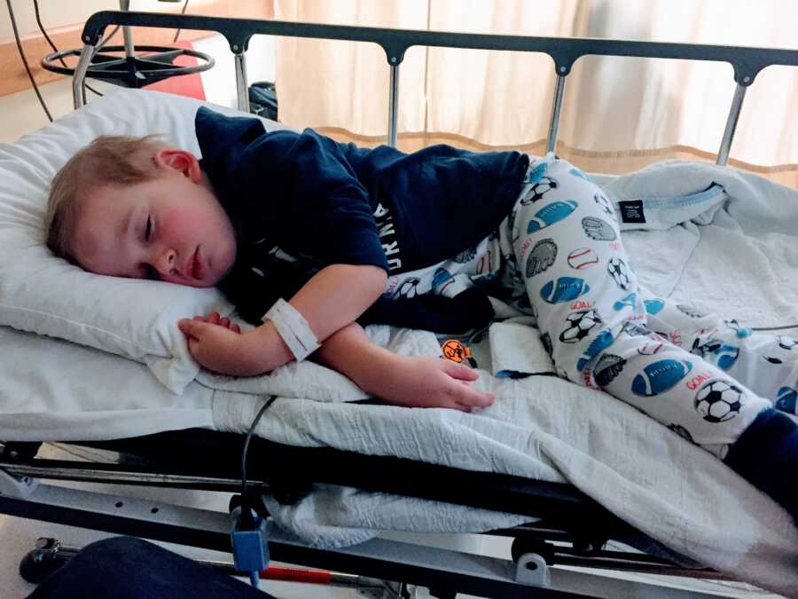 Little boy sleeps in a hospital bed in Toronto during a 6-week stay for various testing