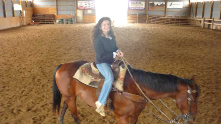 girl with cerebral palsy on horse