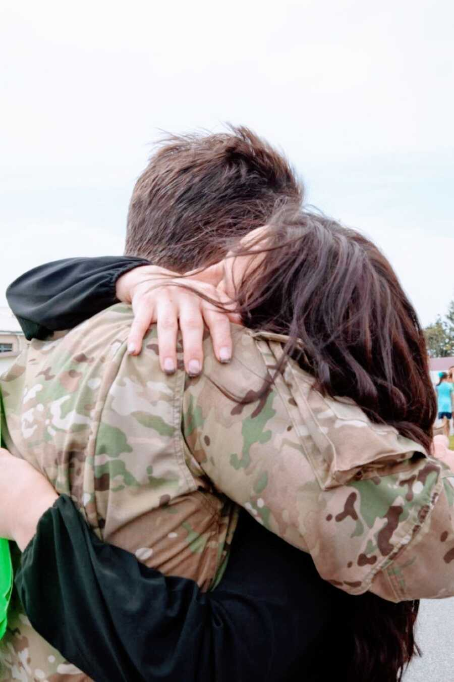 Military wife hugs her husband after he returns from serving in Afghanistan