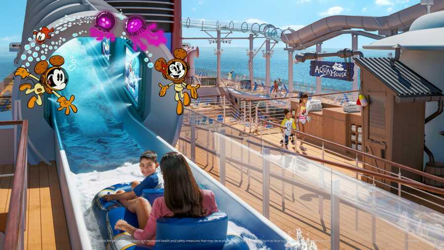 Mom and son sit on a float for the first Disney attraction at sea ride, the Aquamouse on the Disney Wish cruise