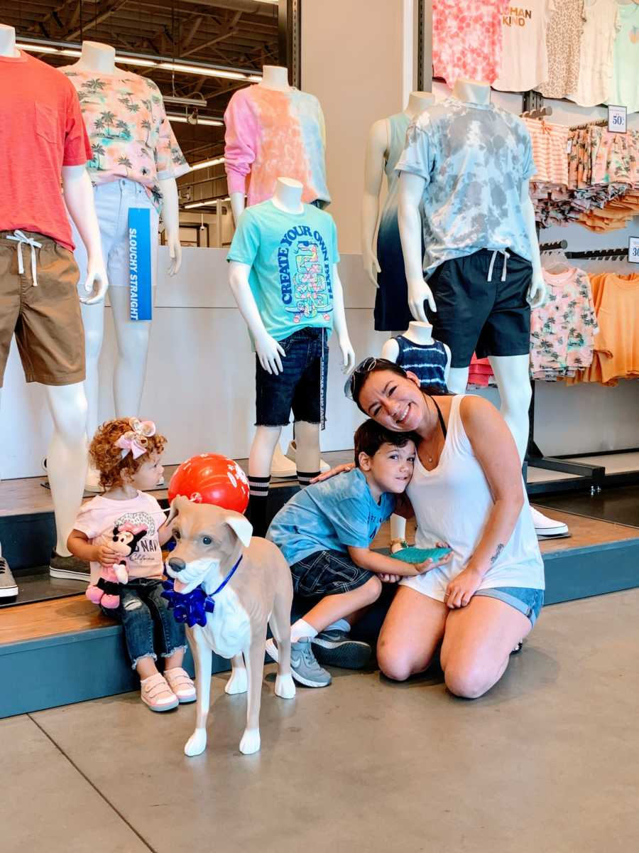 Mom of 2 hugs her autistic son in Old Navy after receiving their very own Old Navy Magic the dog mannequin