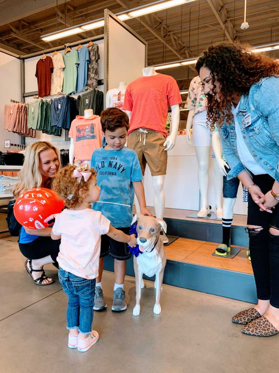 An Old Navy employee gifts an autistic child his very own Magic, the Old Navy mannequin dog