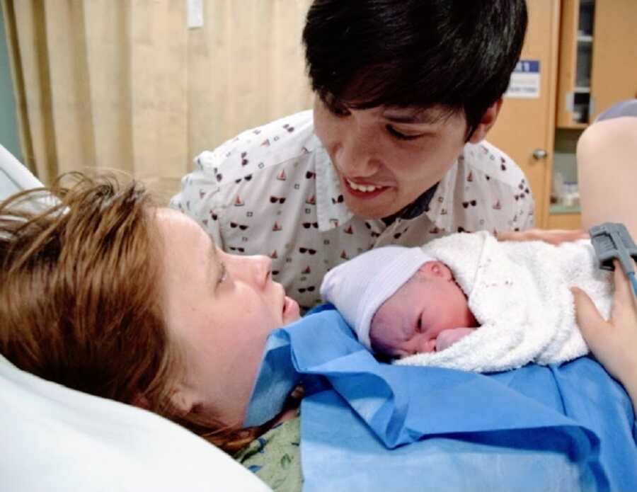 Mom and her husband with newborn baby