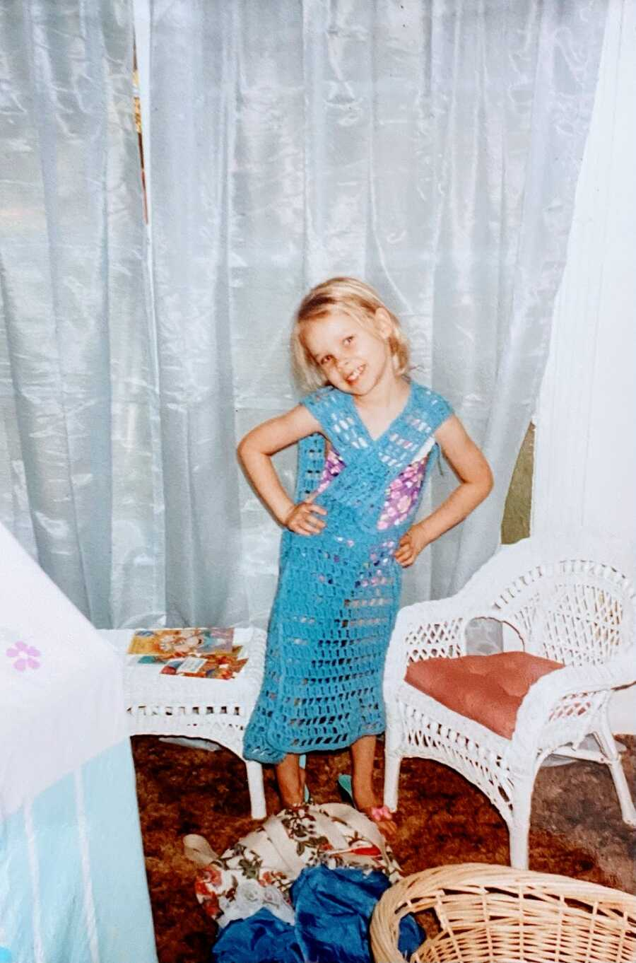 Young girl wearing blue dress
