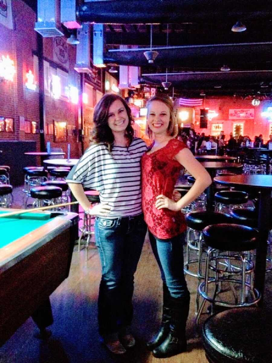 Young woman and a friend in a bar