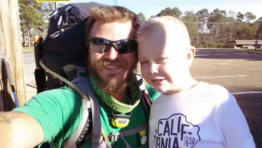 homeless man and cancer survivor child smiling