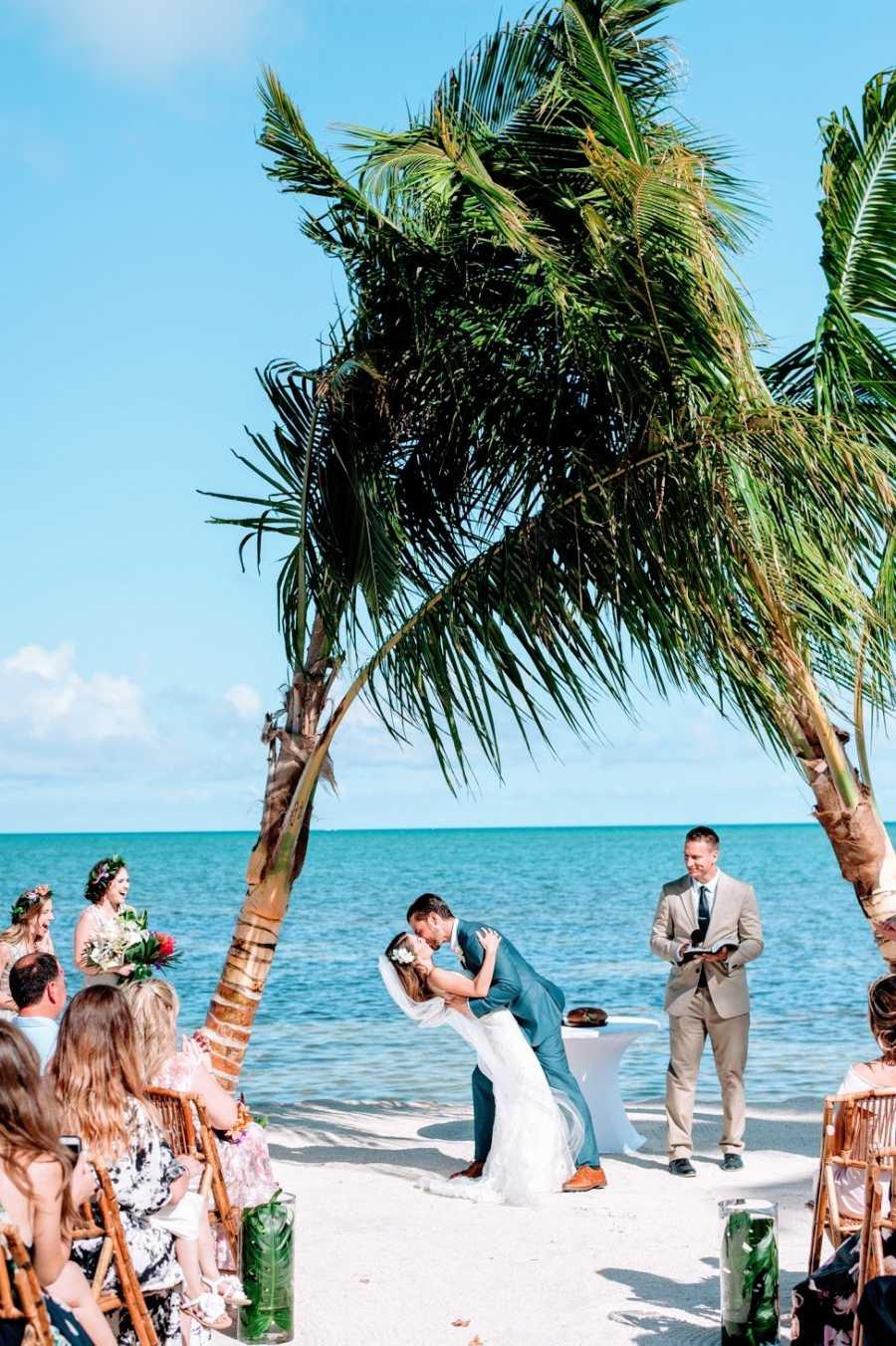 Groom dips chronically ill bride at wedding on beach