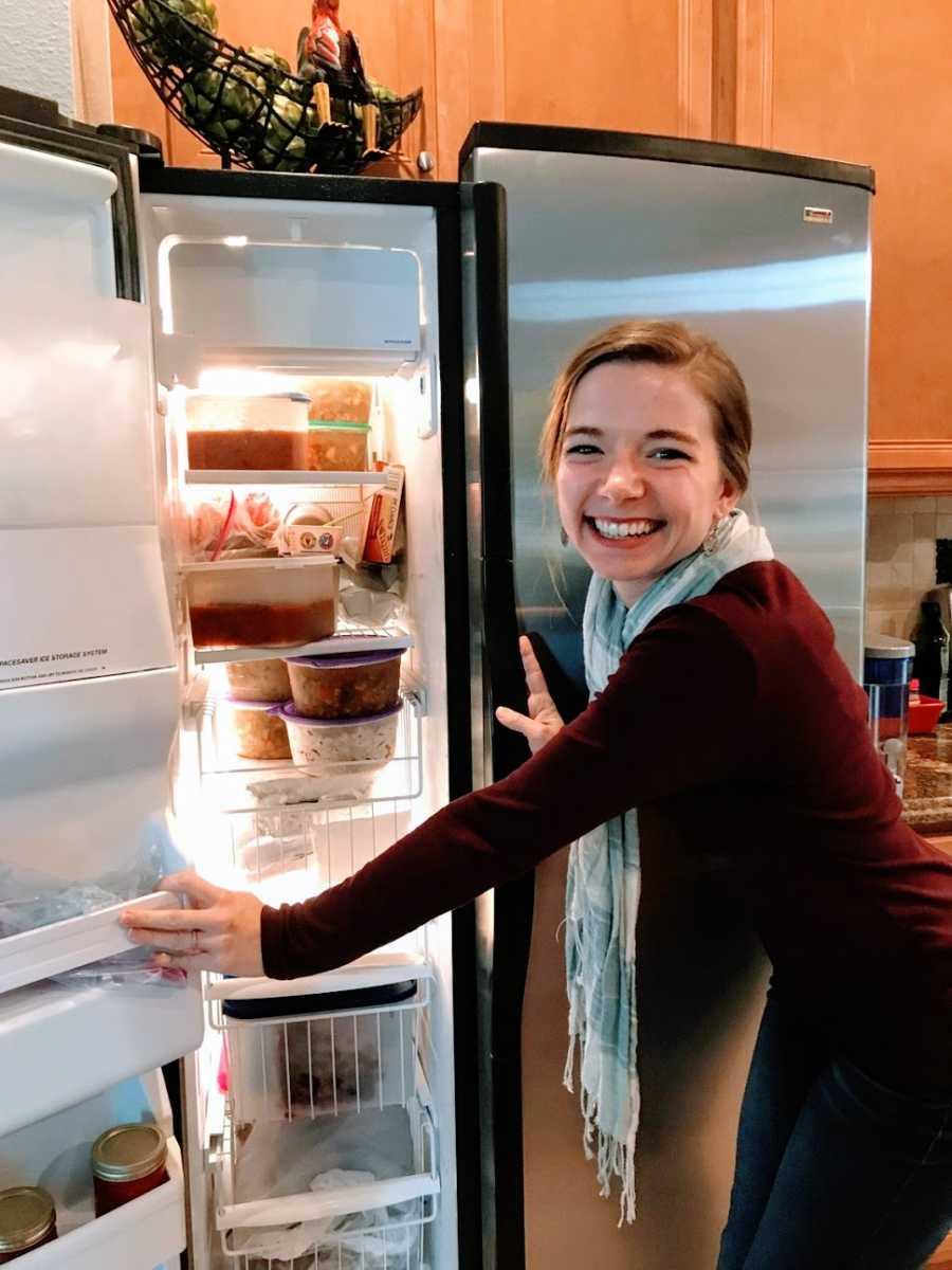 Woman opens packed fridge