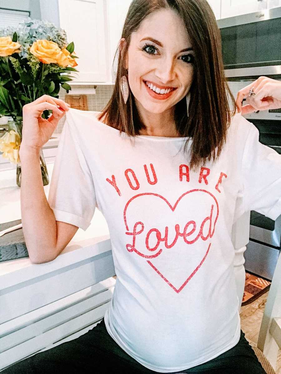 Woman wearing 'You are loved' shirt