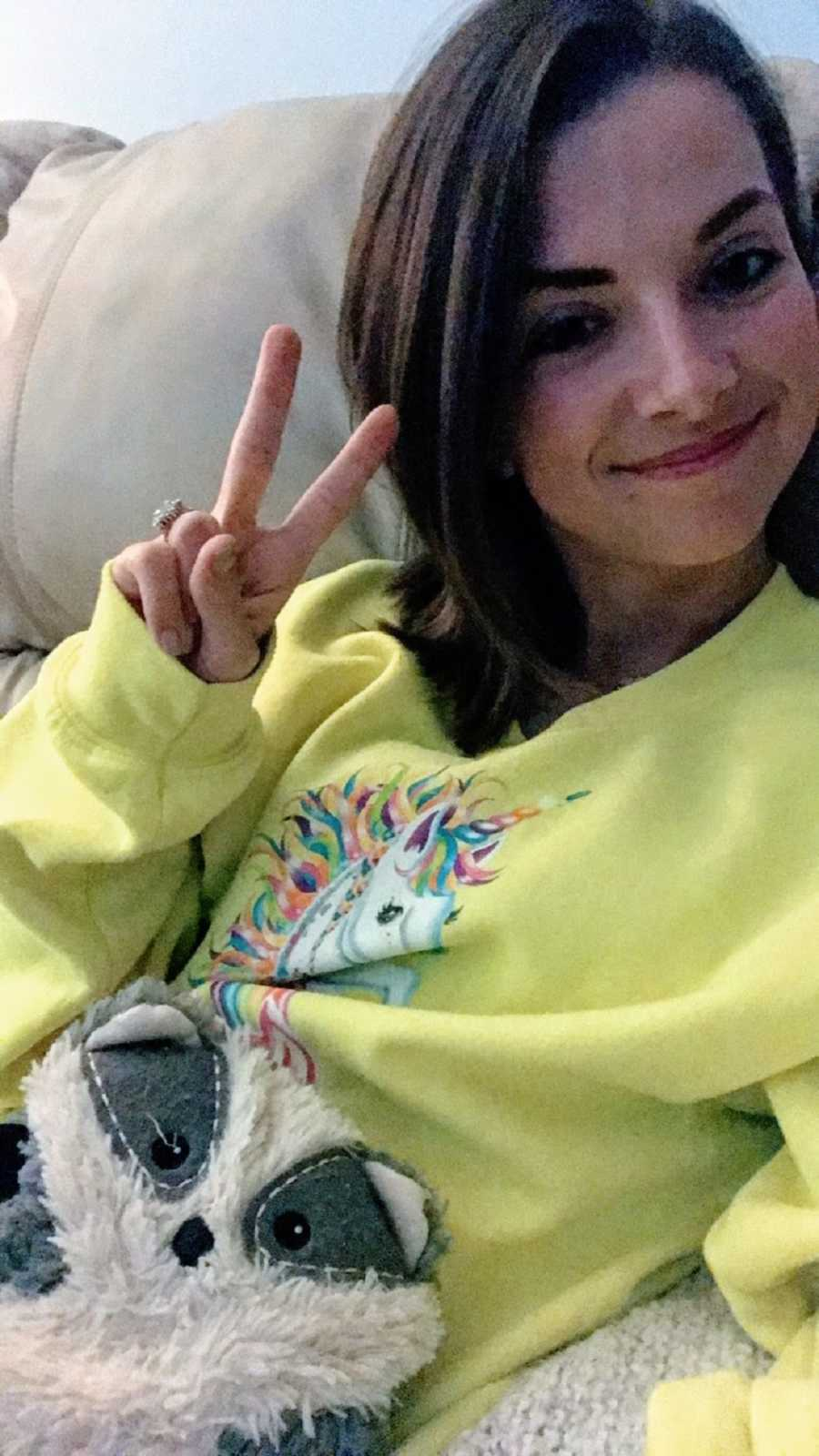 Recovering woman gives peace sign