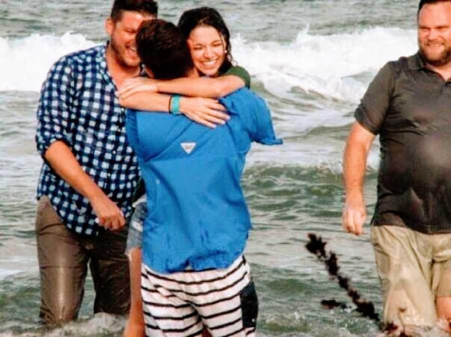 Woman hugs her husband