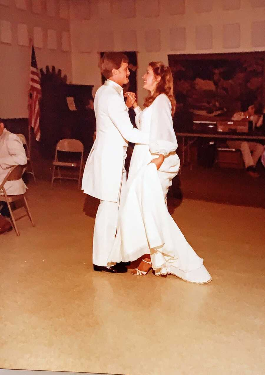 A husband and wife dancing