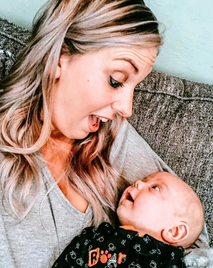 A mother stares in surprise at her baby boy