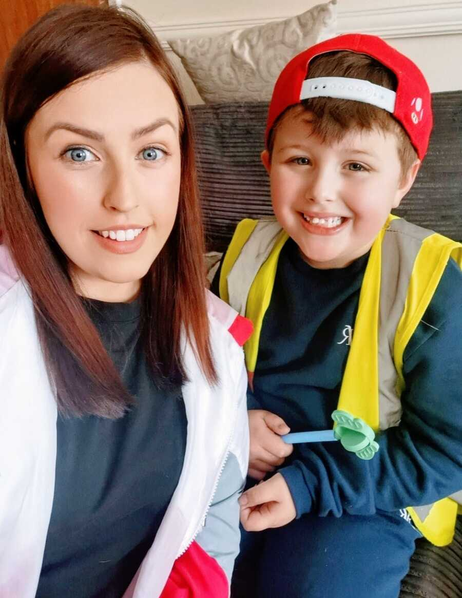 Mom and son with autism who is wearing red hat backwards