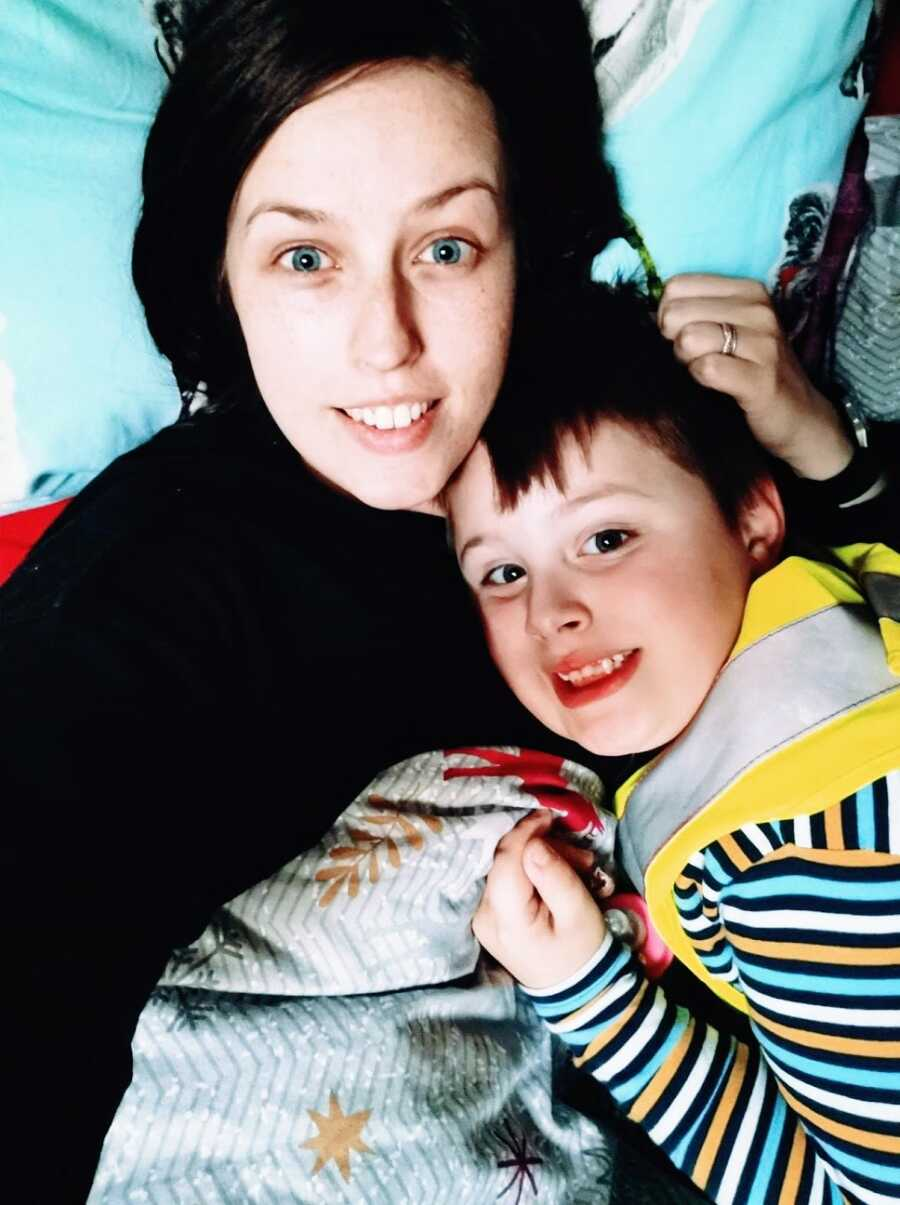 Mom holds son with autism to chest