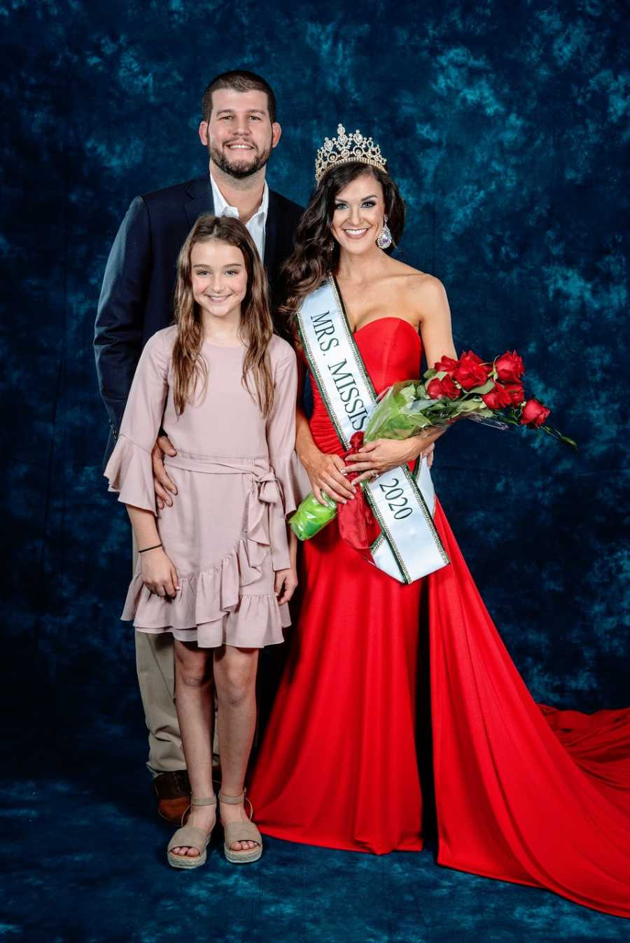 Pageant winner with daughter and husband