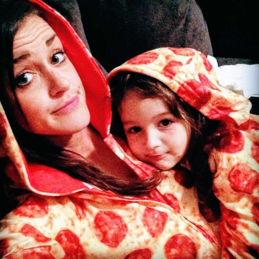 Mother and daughter wearing pizza onesies