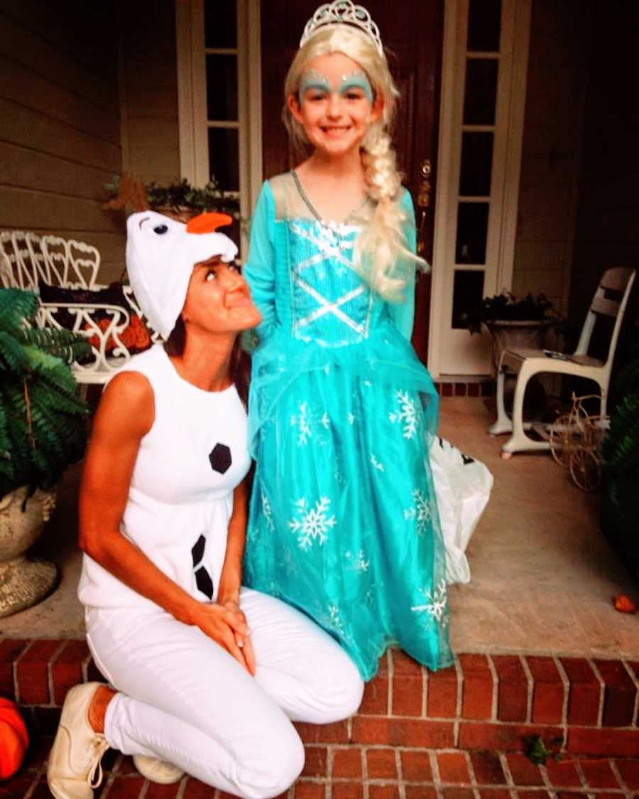 Mom and daughter dressed in Halloween costumes