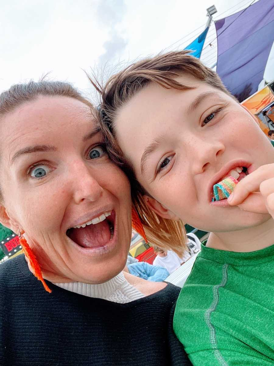 A mom and her young son who has candy in his mouth