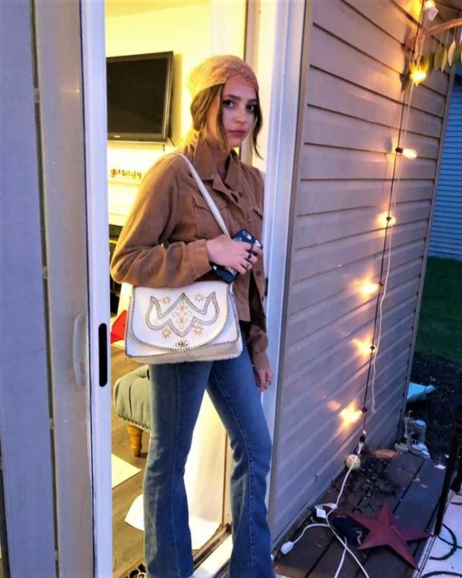 teen posing in doorway