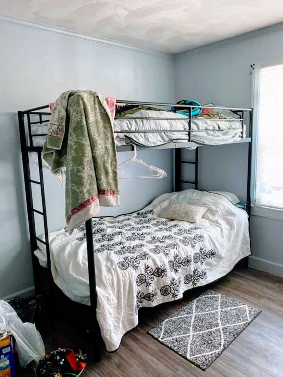 Mom of 3 escaping domestic abuse takes a photo of hers and her son's shared bunkbed in a domestic violence women's shelter