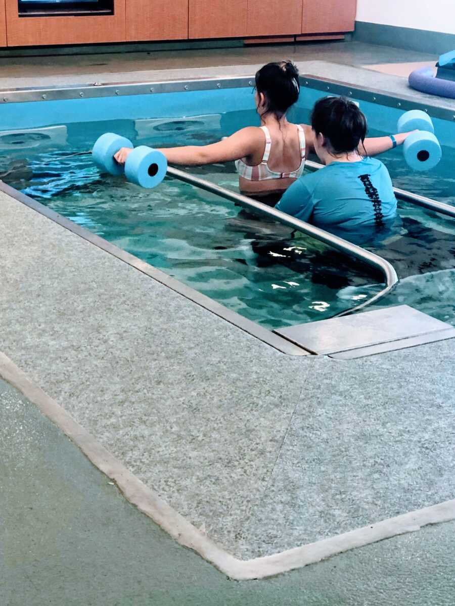 Young girl partially paralyzed from a spinal stroke does physical therapy in the water