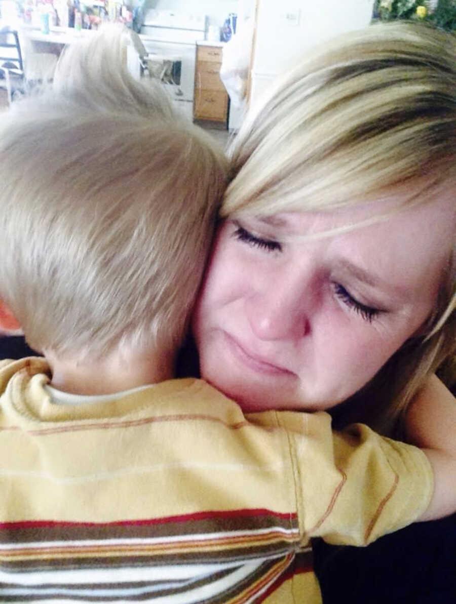 mother sad hugging her child