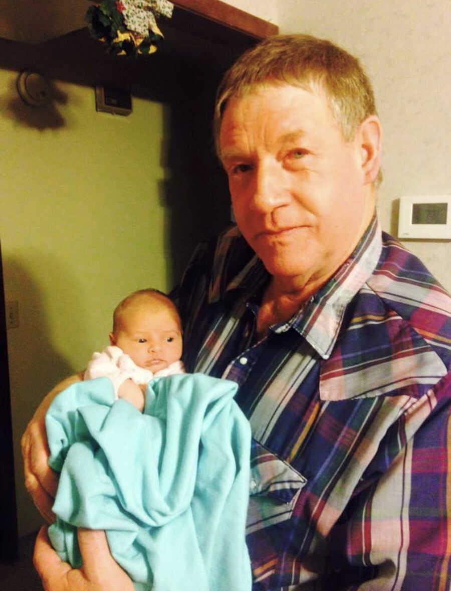 grandpa holding his grand child