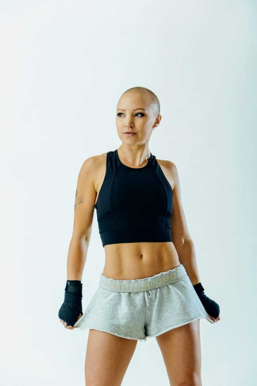 Fitness instructor battling breast cancer takes photos in workout gear, looking as strong as ever