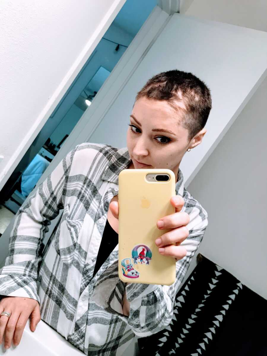 Woman fighting breast cancer lets her kids shave her head before she loses all her hair