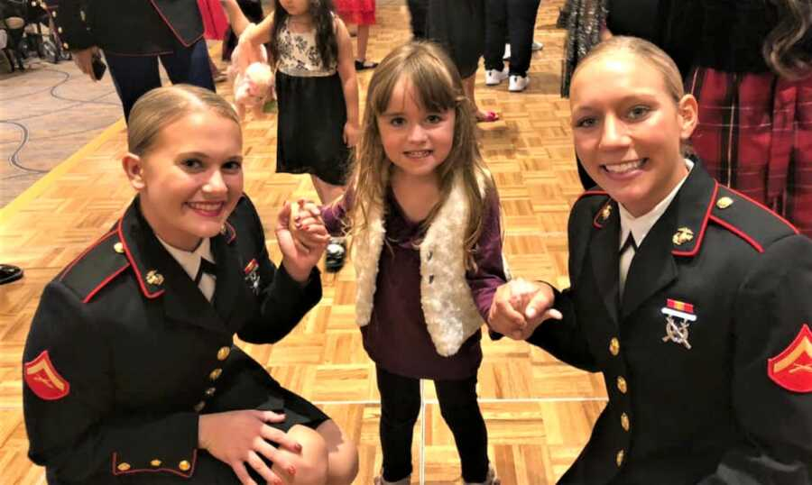 Marines with a little girl