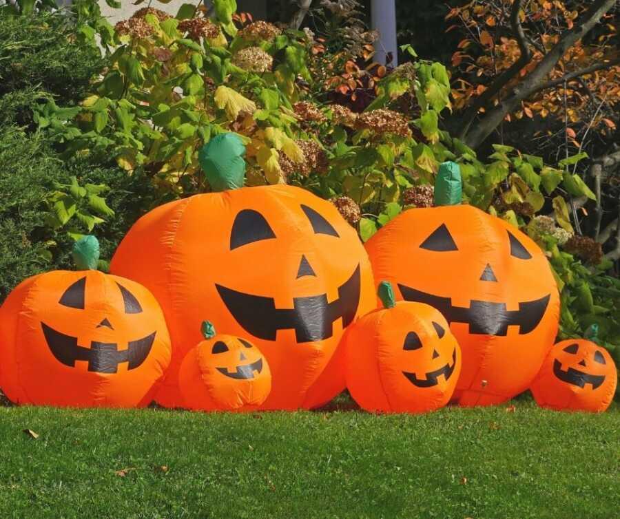 Large inflatable Jack-o-lanterns for yard Halloween decorations.