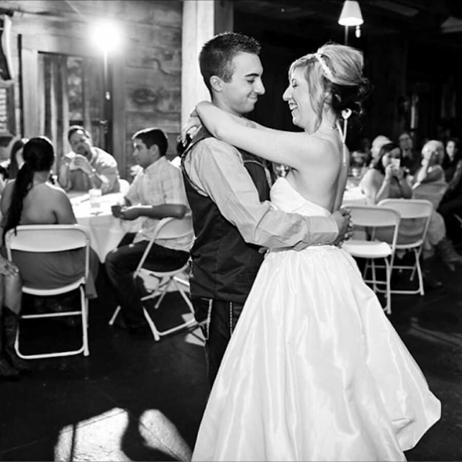 husband spins wife at wedding