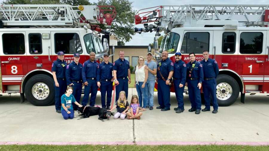Arlington Fire Crew 8 poses for picture with rescued dog and family.