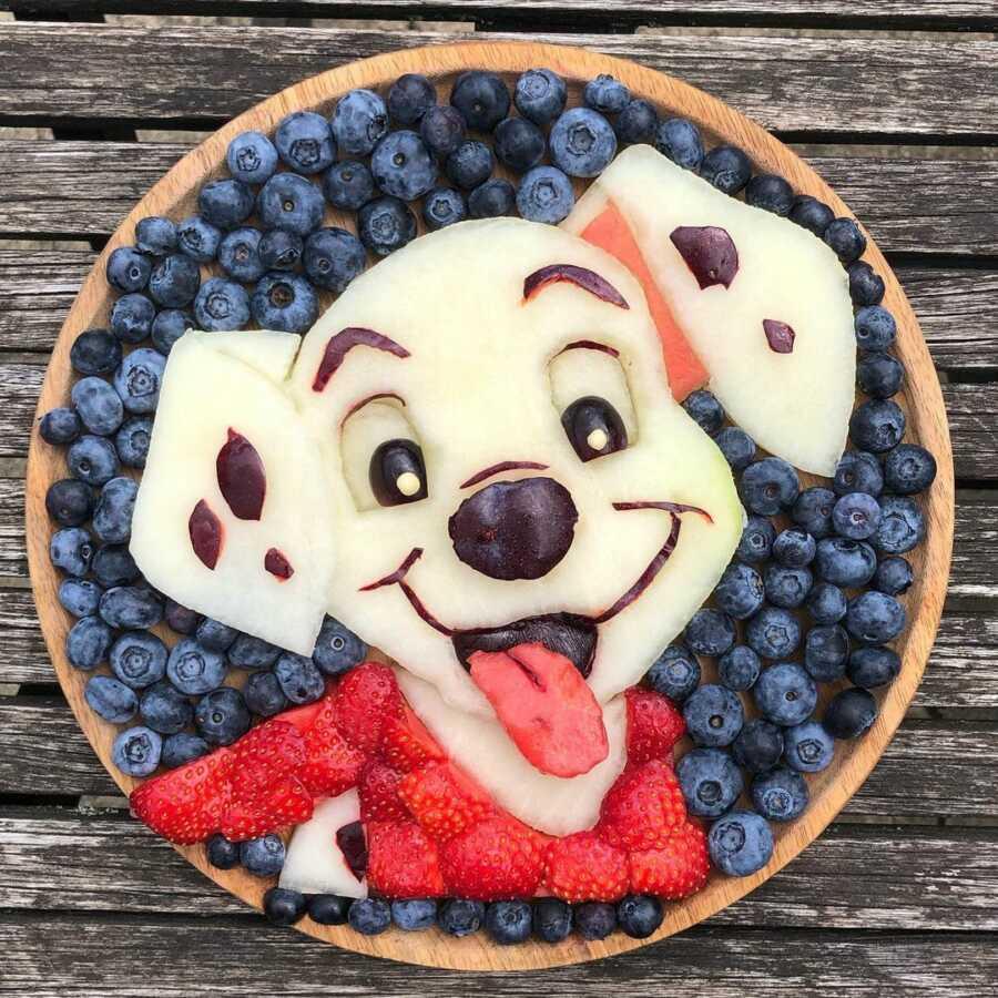Edible food art fruit platter scene of a Dalmatian puppy.