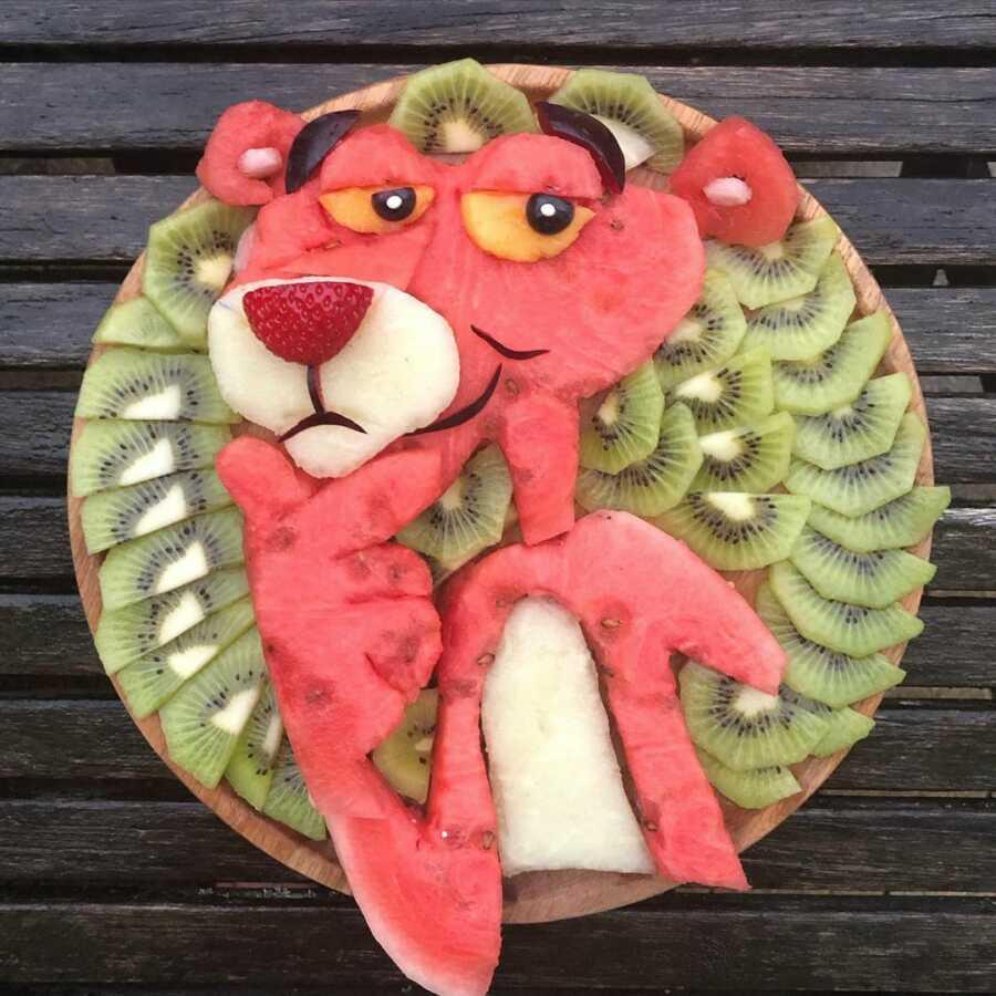 Edible food art fruit platter scene of the Pink Panther.