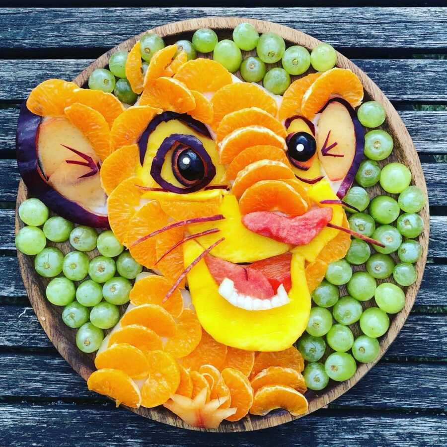 Edible food art fruit platter scene of young Simba from Disney's The Lion King.