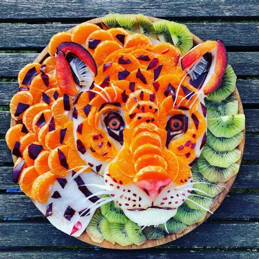 Edible food art fruit platter scene of a cheetah.