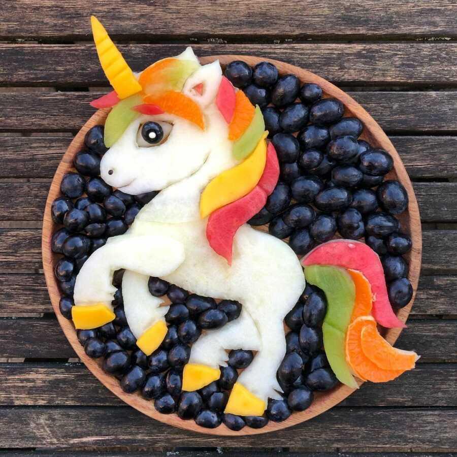 Edible food art fruit platter scene of a unicorn.